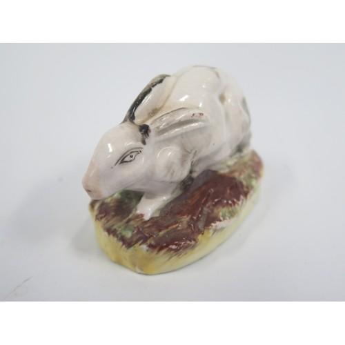 1305A - A 19th Century Staffordshire Rabbit, base 7.5cm