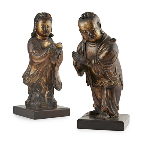 12 - LACQUERED WOODEN FIGURES OF SHANCAI AND LONGNÜ<br><br>QING DYNASTY, 18TH CENTURY <br><br>the boy def...