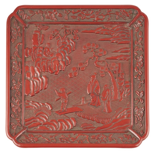 16 - CINNABAR LACQUER QUATREFOIL DISH<br><br>MING DYNASTY, 16TH CENTURY <br><br>carved with two scholar-o...