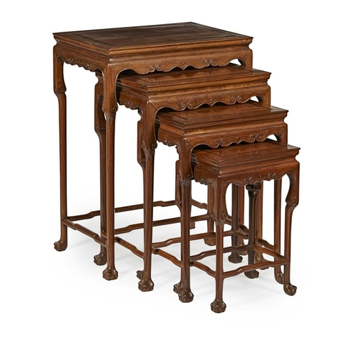 3 - NEST OF FOUR WOODEN TABLES<br><br>LATE QING DYNASTY <br><br>the rectangular top above an apron carve...
