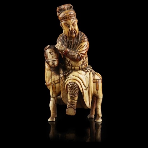 31 - CARVED IVORY EQUESTRIAN FIGURE OF GUANDI<br><br>MING DYNASTY <br><br>Guandi shown seated astride a h...