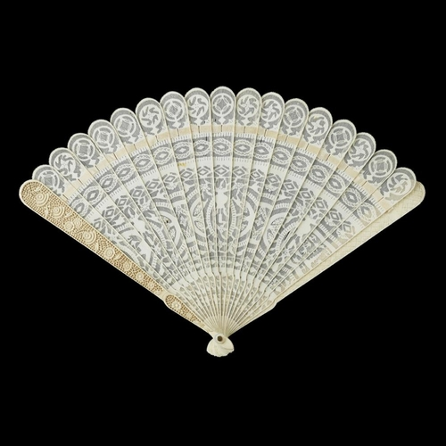 33 - TWO IVORY BRISÉ FANS<br><br>QING DYNASTY, 19TH CENTURY <br><br>the first carved and pierced with sch...