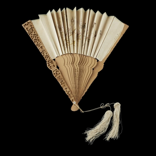 35 - TWO SANDALWOOD FANS<br><br>QING DYNASTY, 19TH CENTURY <br><br>the first comprising nineteen sticks a...
