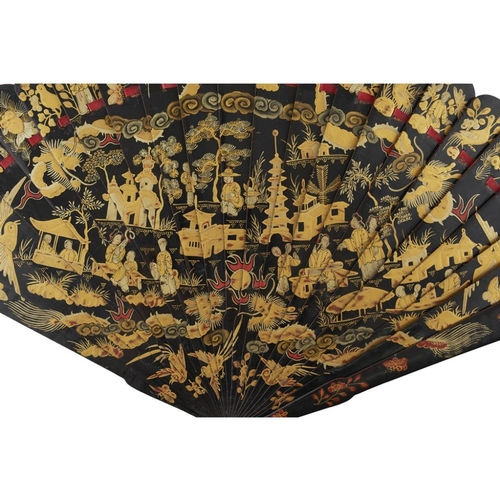 37 - TWO GILT AND BLACK LACQUER BRISÉ FANS<br><br>QING DYNASTY, 19TH CENTURY <br><br>each painted on both...
