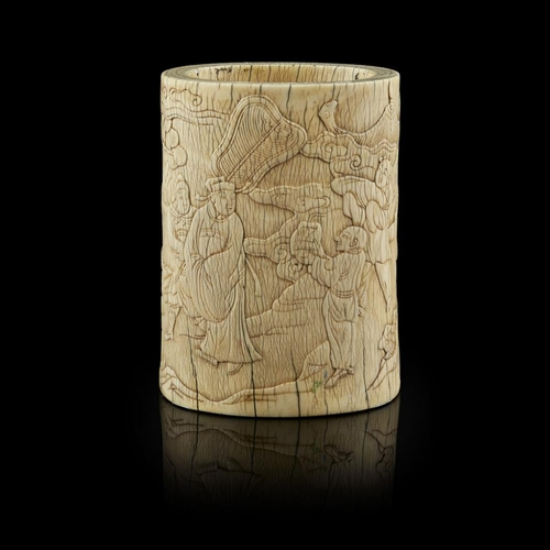 43 - IVORY BRUSH POT<br><br>MING DYNASTY <br><br>the cylindrical vessel carved in low relief with a schol...