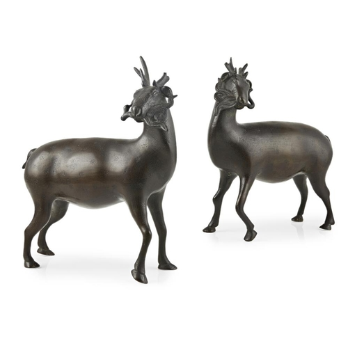 56 - PAIR OF BRONZE DEER<br><br>QING DYNASTY, 18TH CENTURY <br><br>each deer realistically modelled stand...