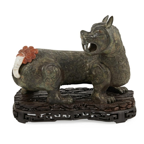 58 - BRONZE MODEL OF A MYTHICAL BEAST<br><br>detailed with bulging round eyes and sharp fangs, turning sh...