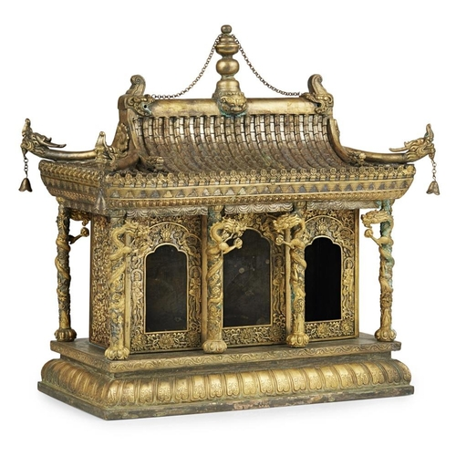 59 - GILT-BRONZE MODEL OF A BUDDHIST SHRINE<br><br>the rectangular chamber fitted with three doors and el...
