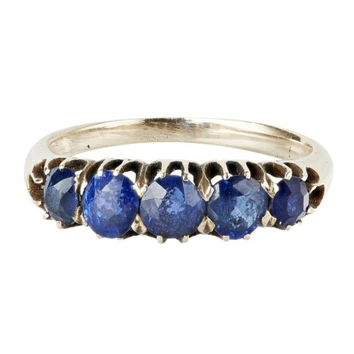 16 - <b>A five stone sapphire set ring</b></i></u> <br /> claw set with five graduated sapphires, to a pl...