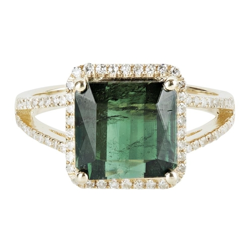 25 - <b>A green tourmaline and diamond set ring</b></i></u> <br /> claw set with a mixed-square cut green...
