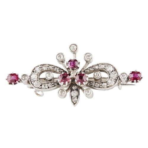 3 - <b>An Edwardian ruby and diamond set brooch</b></i></u> <br /> of symmetrical form, claw set with a ...