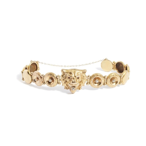 35 - <b>A diamond set bracelet</b></i></u> <br /> modelled as a lion's head, with cabochon garnet eyes an...