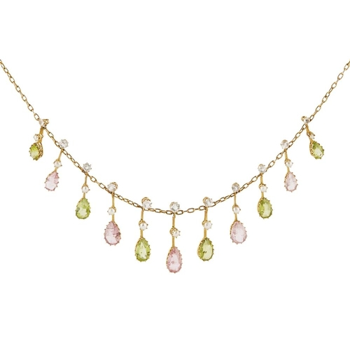 42 - <b>An Edwardian peridot and tourmaline set fringe necklace</b></i></u> <br /> the trace link chain s...