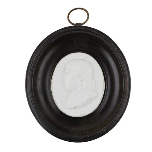 10 - A MINIATURE GLASS PORTRAIT MEDALLION<br><br>DATED 1790 <br><br>inscribed under shoulder A. WAUGH M. ...
