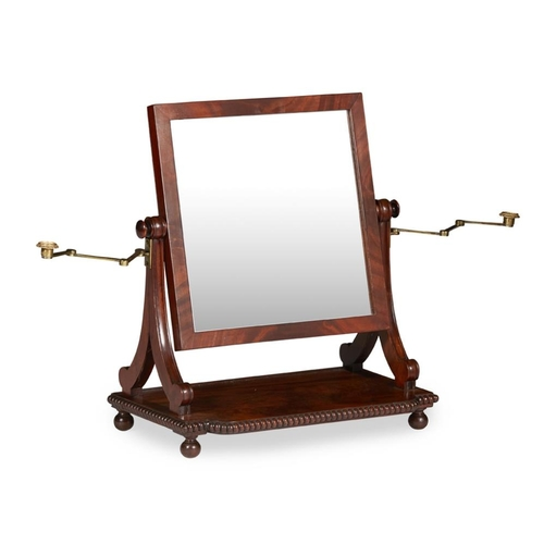 4 - A SCOTTISH REGENCY MAHOGANY TOILET MIRROR<br><br>CIRCA 1830 <br><br>the rectangular frame with divid...