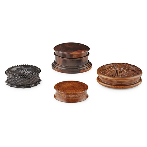 43 - FOUR TURNED AND CARVED WOOD SNUFF BOXES<br><br>19TH CENTURY <br><br>all of circular form, comprising...