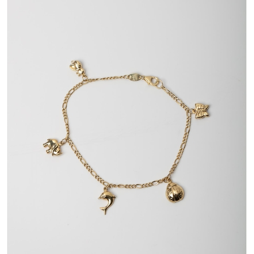 16 - A 9CT GOLD & SILVER BONDED CHARM  BRACELET A 21cm long charm bracelet crafted in 1/10 9ct yellow gol...