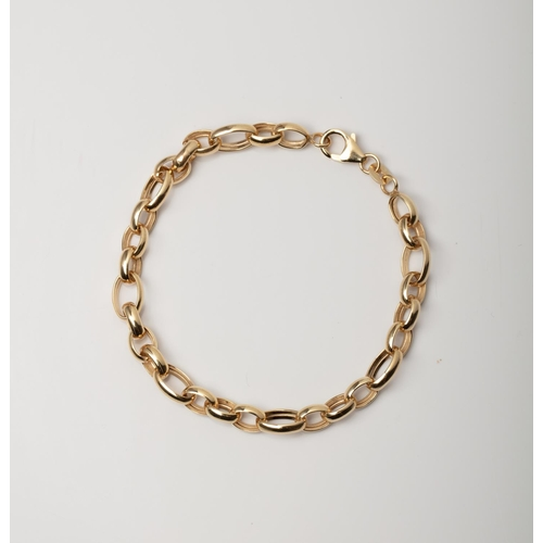 17 - A 9CT GOLD & SILVER BONDED FANCY LINK BRACELET A 19cm long fancy link bracelet crafted in 1/10 9ct y...