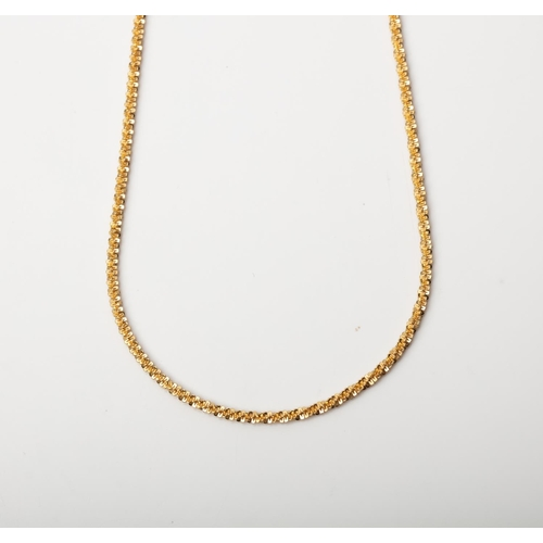 25 - A 9CT GOLD AND SILVER BONDED ROLO CHAIN A 45cm long Rope chain crafted in 1/10 9ct yellow gold and S...