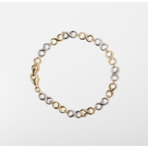 36 - A 9CT & SILVER BONDED TWO TONE INFINITY BRACELET A 19cm long Infinity Link bracelet crafted in 1/10 ...