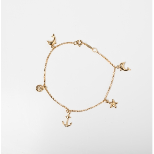 38 - A 9CT GOLD & SILVER BONDED CHARM  BRACELET A 19cm long charm bracelet crafted in 1/10 9ct yellow gol...