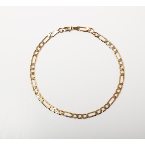 53 - A 9CT GOLD  FIGARO BRACELET A 21cm long Figaro bracelet crafted in 9ct yellow gold weighing 3.76 gra...