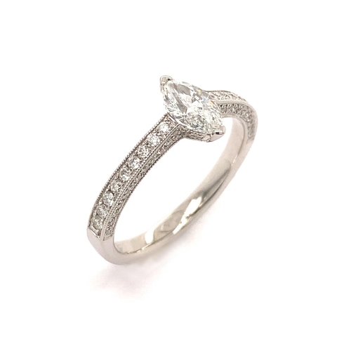 10 - A MARQUISE CUT DIAMOND RING WITH DIAMONDS ON THE BAND <br /><br />A Marquise Cut Diamond Ring with d...