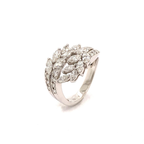 12 - A LEAF DESIGN CROSSOVER DIAMOND DRESS RING <br /><br />A Leaf Design Crossover Diamond Dress Ring in...