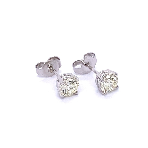 27 - A CLASSIC PAIR OF 4 CLAW SOLITAIRE DIAMOND STUD EARRINGS <br /><br />A pair of Classic 4 Claw Solita...