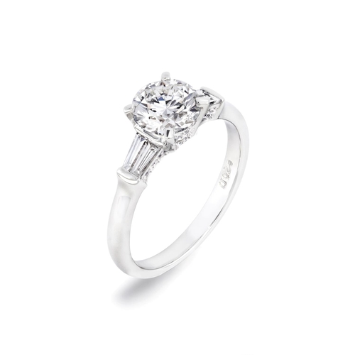 4 - A TRILOGY DESIGN DIAMOND ENGAGEMENT RING <br /><br />A Trilogy Design Diamond Engagement Ring in Pla...