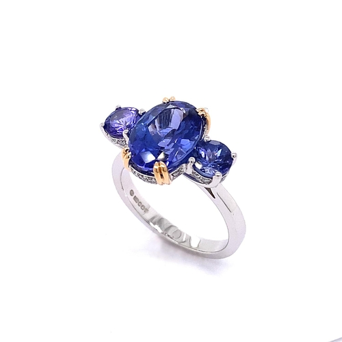 40 - A TRILOGY TANZANITE RING WITH MICRO SET DIAMONDS <br /><br />Crafted in 18K White Gold, the Trilogy ...