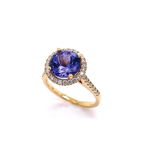 41 - A CLASSIC HALO DESIGN TANZANITE AND DIAMOND RING <br /><br />Crafted in 18K Yellow Gold, the Halo De...