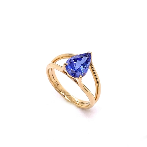 42 - A SPLIT SHANK FANCY CUT TANZANITE DRESS RING <br /><br />A Split Shank Fancy Cut Tanzanite Dress Rin...