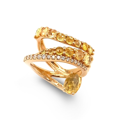 5 - A YELLOW SAPPHIRE AND DIAMOND DRESS RING <br /><br />A Yellow Sapphire and Diamond Dress Ring in 18K...