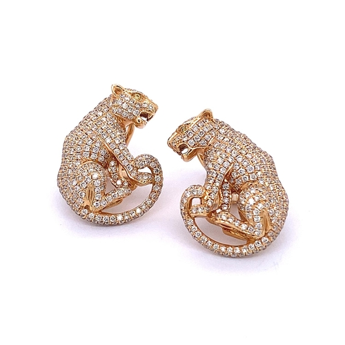 99 - A PAIR OF SITTING LEOPARD DIAMOND EARRINGS <br /><br />A pair of Sitting Leopard Diamond Earrings in...