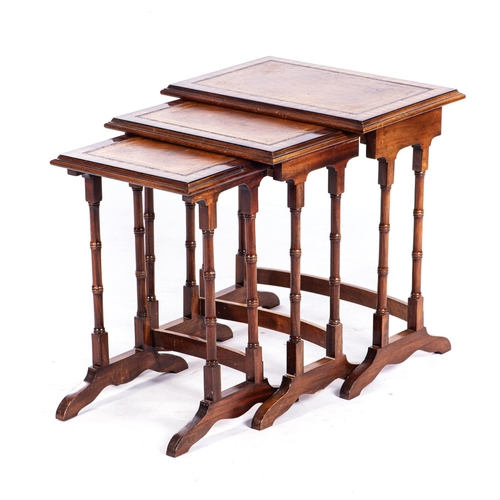 27 - A NEST OF THREE REGENCY STYLE MAHOGANY TABLES...