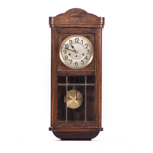 46 - AN OAK CHIMING WALL CLOCK, EARLY 20th CENTURY...