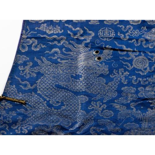1003 - A CHINESE BLUE GROUND SILK BROCADE NINE DRAGON COURT ROBE, 'JIFU', QING DYNASTY, LATE 19TH CENTURY