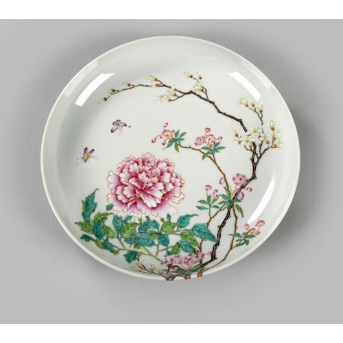1002 - A CHINESE FAMILLE ROSE 'PEONY, PRUNUS AND MAGNOLIA' PLATE, LATE REPUBLIC PERIOD, 1912 - 1949