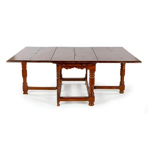 295 - A CAPE TEAK PEG TOP GATELEG TABLE, MANUFACTURED BY PIERRE CRONJE