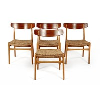 A SET OF FOUR TEAK AND BEECH CH-23 DINING CHAIRS, DESIGNED BY HANS WEGNER IN 1950, MANUFACTURED BY ANDREAS TUCK
