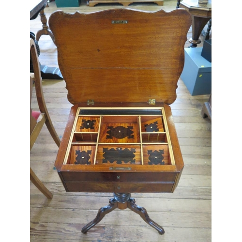 32 - A mid Victorian cross-banded mahogany tripod sewing table, the shaped hinged top enclosing inlaid co...