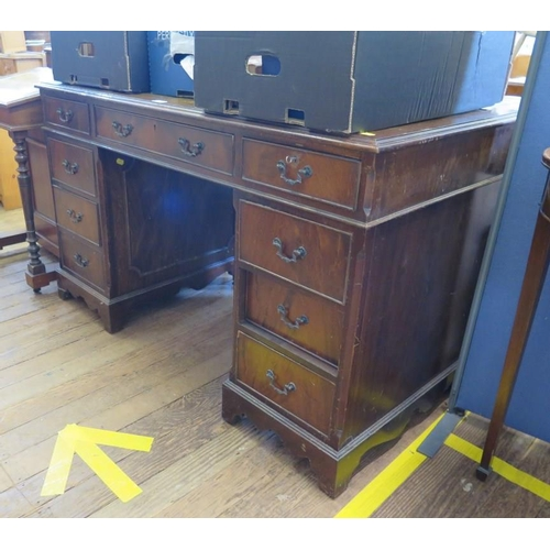 1 - A reproduction mahogany pedestal desk, the freize drawers over pedestals each with three drawers, 12...