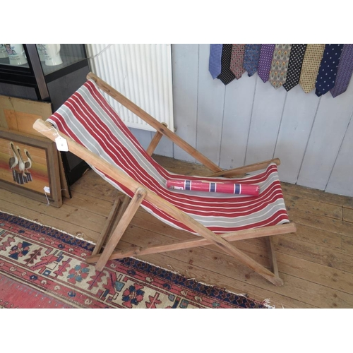 14 - A vintage deck chair, 124cm with a John Lewis deck chair replacement canvas pack (with pins)...