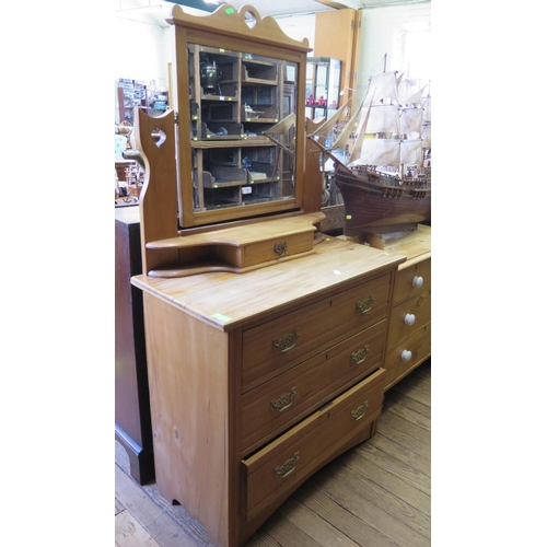 15 - An Edwardian pine dressing chest, the swing mirror over three long graduated drawers, 91 cm wide, 16...