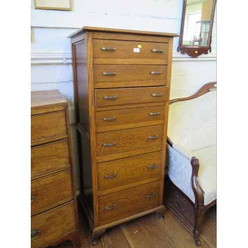 2 - A 1930s oak tallboy, with seven graduated drawers, on cabriole legs, 61 cm wide,138 cm high...
