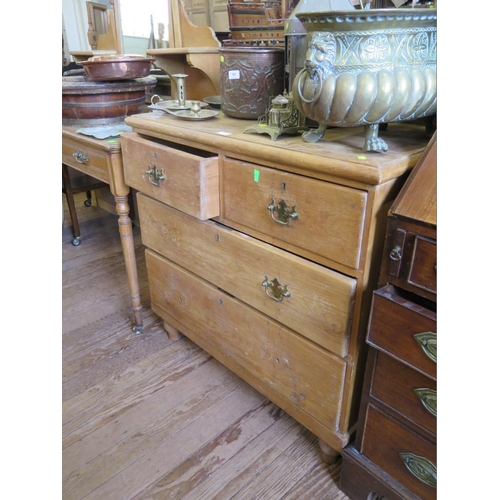 21 - A Victorian pine chest of drawers, with two short and two long graduated drawers, with brass handles...
