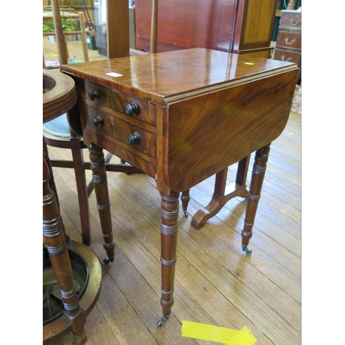 23 - A Regency crossbanded mahogany Pembroke table, the hinged top over two frieze drawers on ring turned...
