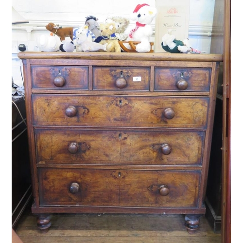 24 - A walnut chest of drawers, with three short and three long graduated featherbanded drawers, on turne...