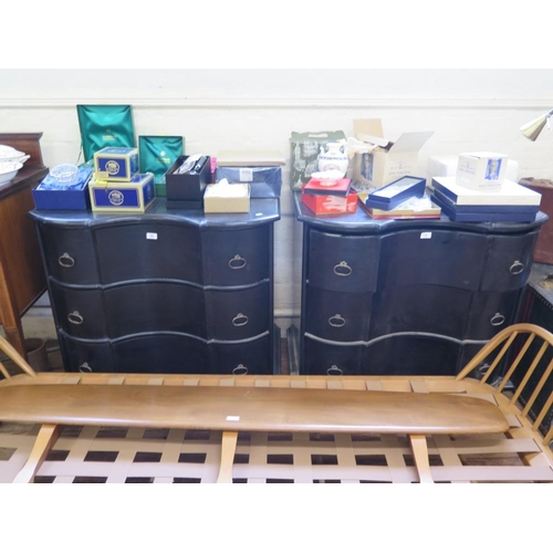 36 - A pair of ebonised continental style chests of drawers, each with shaped fronts over three long draw...